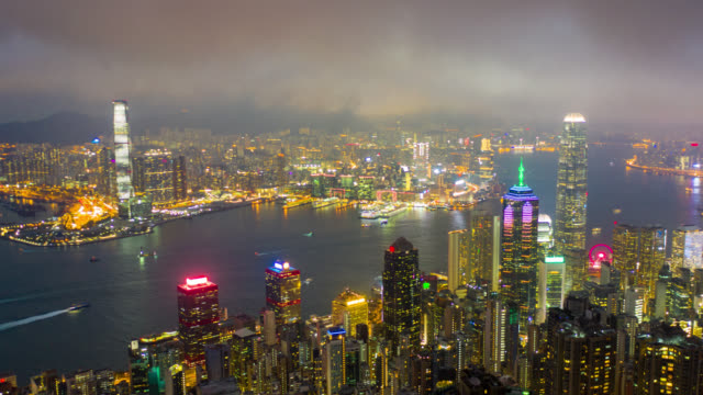 hyperlapse aerial view of cityscape downtown traffic in victoria harbour at hong kong china at night - hong kong stock videos & royalty-free footage