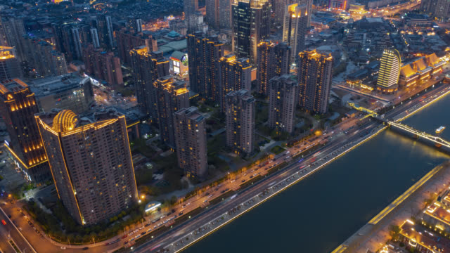 hyperlapse aerial view of residential building along the river - hai river stock videos & royalty-free footage