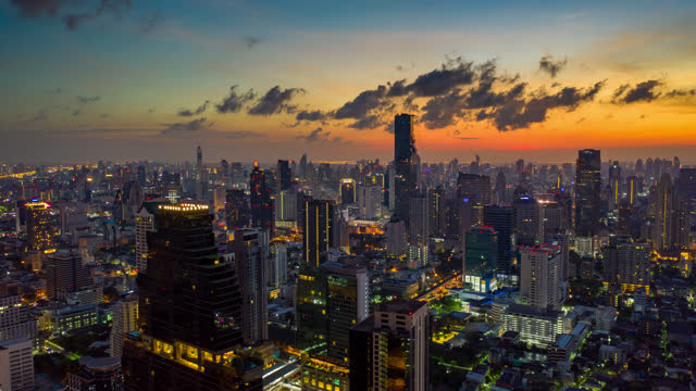 hyperlapse aerial view of the bangkok city thailand at sunrise - elevated train stock videos & royalty-free footage