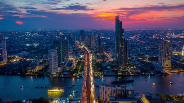 Hyperlapse aerial view of the Bangkok landmark financial business district with skyscraper over Chao Phraya River at Bangkok