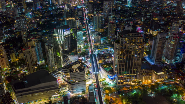 Hyperlapse aerial view of the Bangkok landmark financial business district with skyscraper on Sukhumvit district in Bangkok city at night