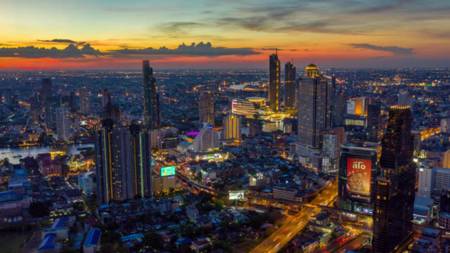 hyperlapse aerial view of the bangkok landmark financial business district with skyscraper over chao phraya river at bangkok thailand in sunset - bangkok stock videos & royalty-free footage