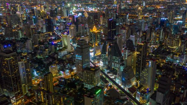 Hyperlapse aerial view of the Bangkok landmark financial business district with skyscraper on Asoke district in Bangkok city at night