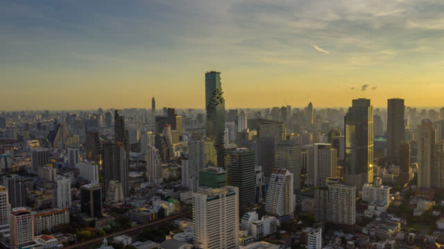 hyperlapse aerial view of the bangkok landmark financial business district with skyscraper in bangkok city thailand at sunrise - bangkok stock videos & royalty-free footage