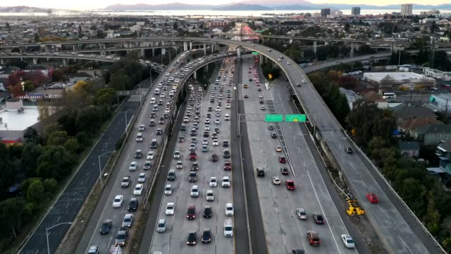hyperlapse, aerial view of traffic on city's freeway - traffic time lapse stock videos & royalty-free footage