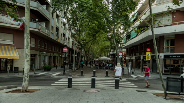 hyperlapse barcelona rambla de poblenou with independentist simbol in a laight street at the end - pedestrian zone stock videos & royalty-free footage