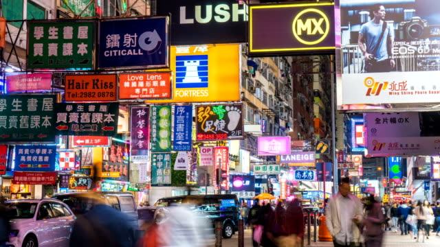 4k hyperlapse - business neon signs of mong kok pedestrian street - image stock videos & royalty-free footage