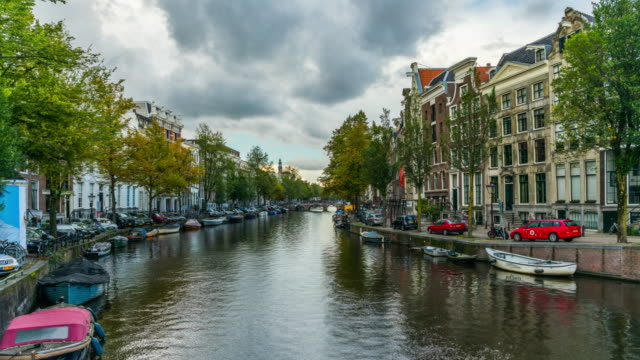 hyperlapse : canal in amsterdam, netherlands - amsterdam stock videos & royalty-free footage
