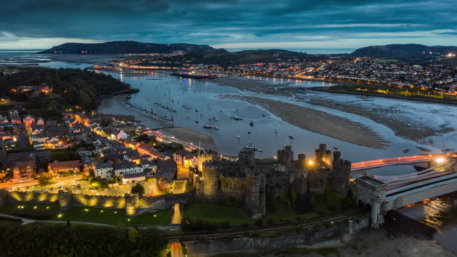 hyperlapse: castle and harbor cowny - north wales - wales stock videos & royalty-free footage