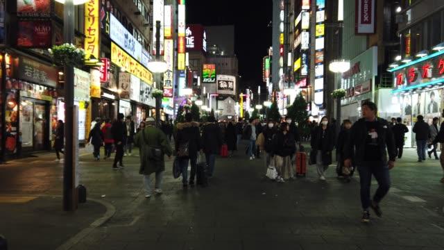 4k hyperlapse. crowd on kabukicho at night, tokyo , japan - city street stock videos & royalty-free footage