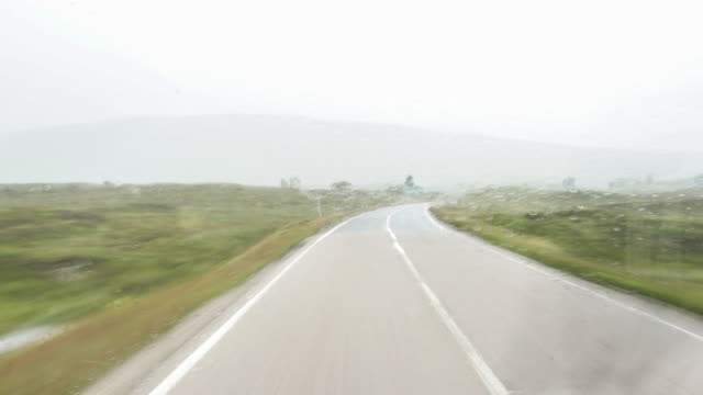 hyper-lapse, driving in scotland in the pouring rain. - car interior stock videos & royalty-free footage