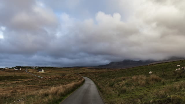 hyperlapse t/l pov driving on isle of skye with high speed moving clouds - rural scene stock videos & royalty-free footage