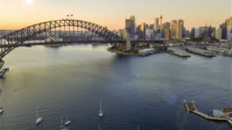 Hyperlapse drone lapse of Sydney city skyline during sunrise.