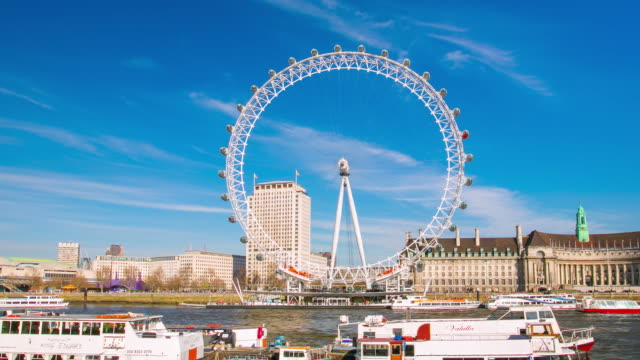 hyperlapse footage of london eye and river thames in london. - millennium wheel stock videos and b-roll footage