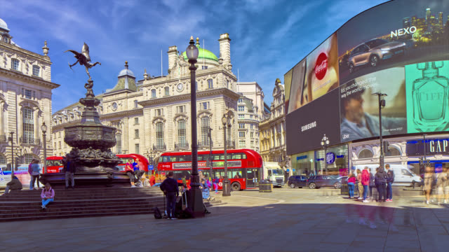 hyper-lapse footage of walking between tourists in london's piccadilly circus with advertising billboards and buses in the background. - double decker bus stock videos & royalty-free footage