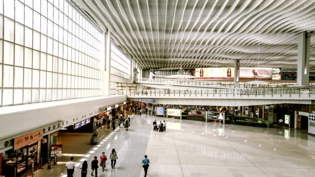 hyperlapse inside airport terminal - hong kong international airport stock videos and b-roll footage