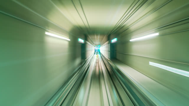 hyperlapse of automatic train moving to tunnel for transit to terminal in incheon international airport near seoul city, south korea - underground stock videos & royalty-free footage