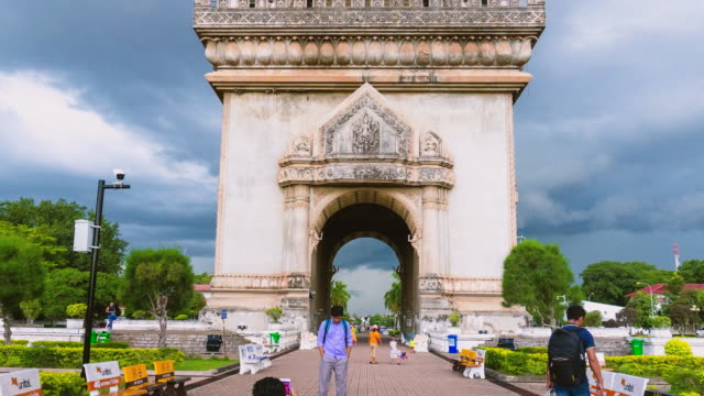 hyperlapse of beautiful of patuxai in evening before rain , war arch monument in vientiane laos. - laos stock videos and b-roll footage