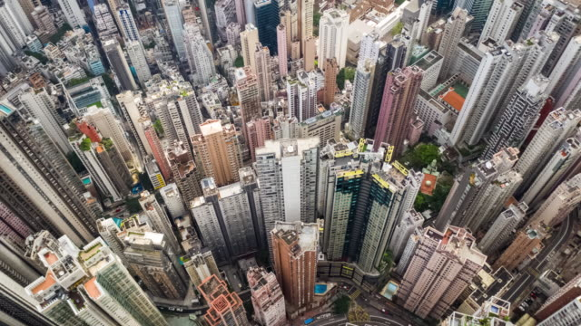 hyperlapse of cityscape crowded building in hong kong - inquadratura da un aereo video stock e b–roll