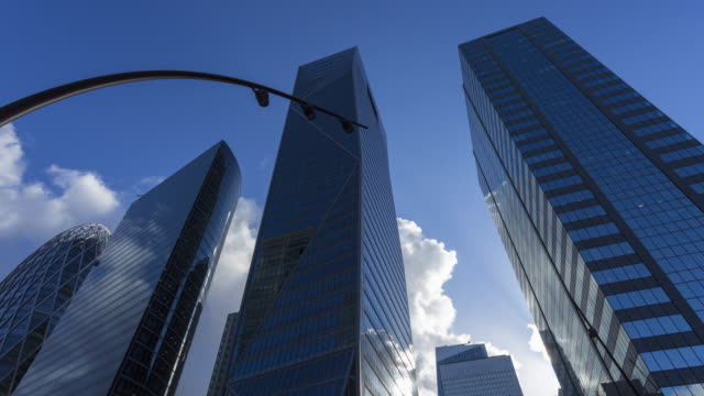 hyperlapse of corporate buildings in financial / business district - corporate business stock videos & royalty-free footage