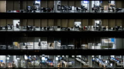 Hyperlapse of corporate life in glass office center at night, timelapse background.