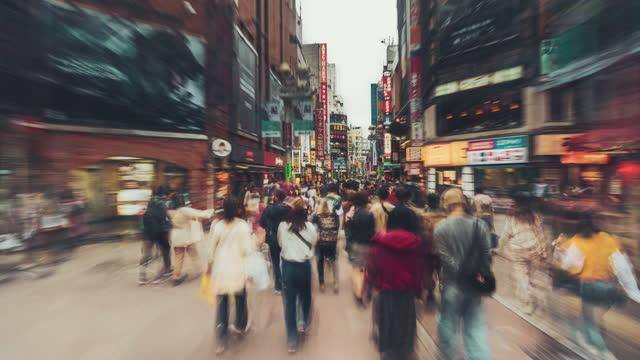 hyperlapse of crowd in shibuya at night, japan - pedestrian stock videos & royalty-free footage
