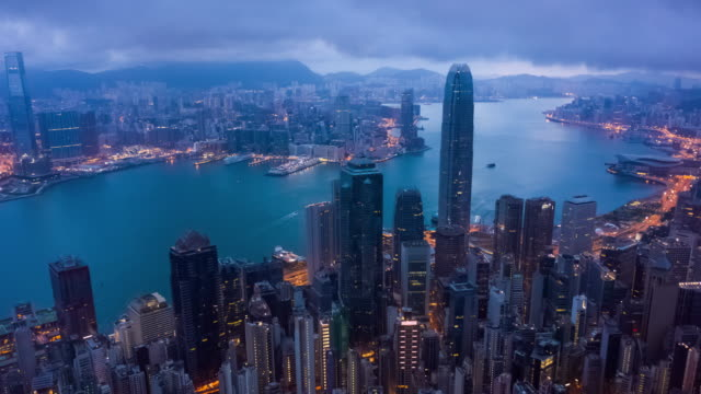 hyperlapse of hong kong skyscraper and cityscape in twilight time - victoria peak stock videos & royalty-free footage