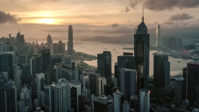 hyperlapse of hong kong urban skyline in sunset time - victoria harbour hong kong stock videos & royalty-free footage
