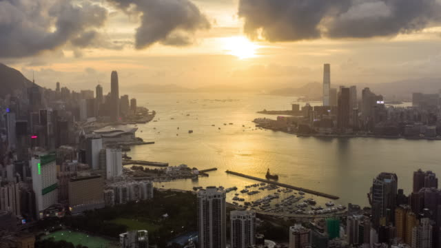 hyperlapse of hong kong urban skyline in sunset time with zoom out - victoria harbour hong kong stock videos & royalty-free footage