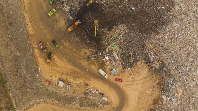 hyperlapse of large stack garbage dump in top view - soil stock videos & royalty-free footage
