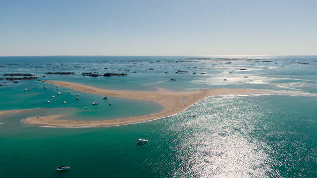 hyperlapse of low tide sand bar with boats - channel islands england stock videos & royalty-free footage