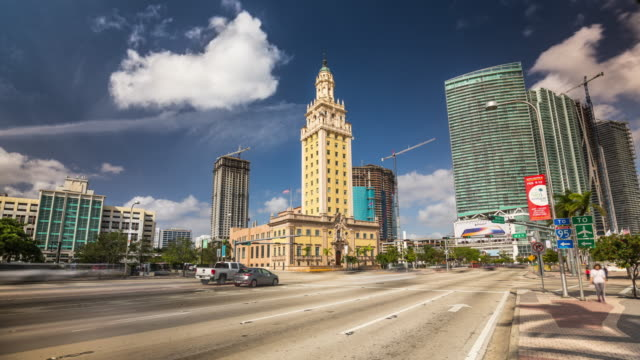 hyperlapse of miami's freedom tower with city traffic, florida. usa - cuban culture stock videos & royalty-free footage