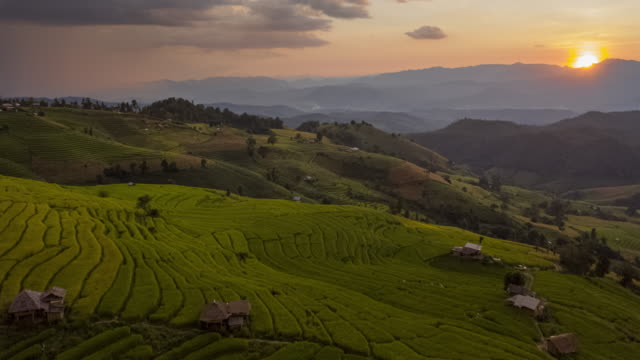 hyperlapse of rice terrace aerial view with cloudy sky - village stock videos & royalty-free footage