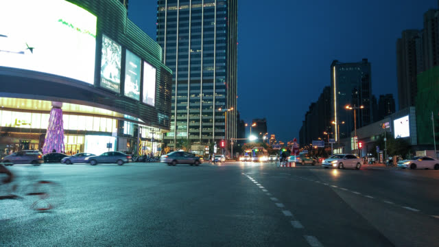 hyperlapse of road intersection traffic - liyao xie stock videos & royalty-free footage