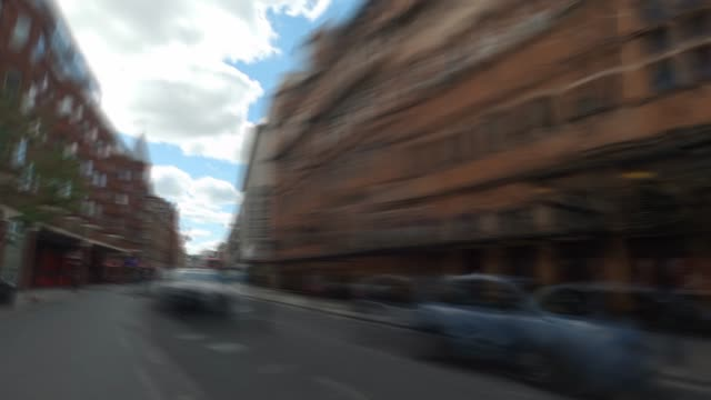 a hyperlapse of shaftesbury avenue focusing on the closed theatres of the west end on may 02 2020 in london england the uk remains in full lockdown... - distant stock videos & royalty-free footage
