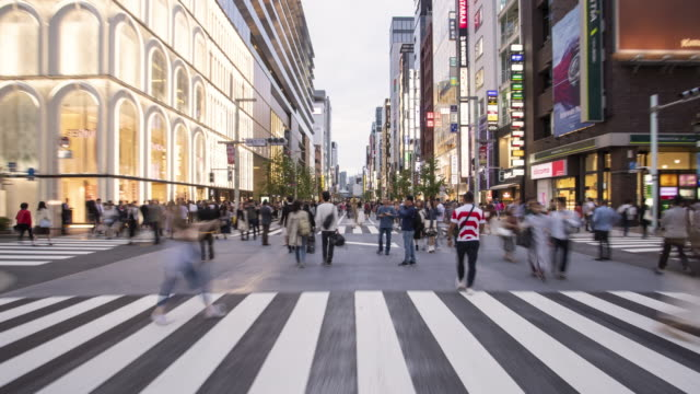 hyperlapse of shoppers on chuo-dori ave, ginza / tokyo, japan - diminishing perspective stock videos & royalty-free footage