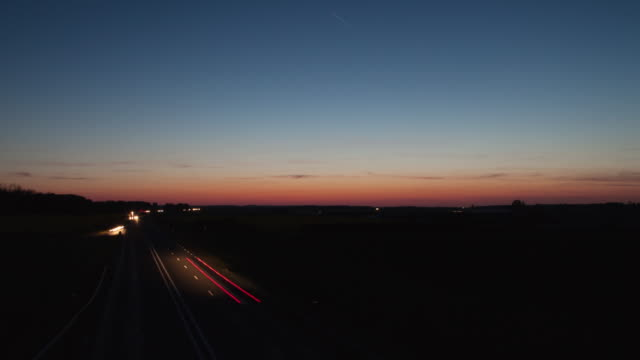 Hyperlapse on a bridge over a freeway at sunset
