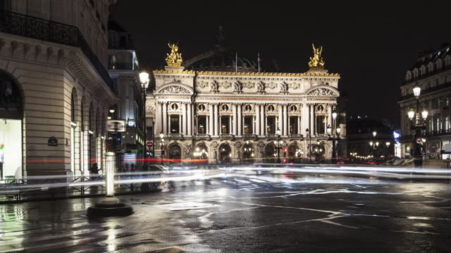 hyperlapse on place de l'opera with light trails at night - paris france stock videos & royalty-free footage