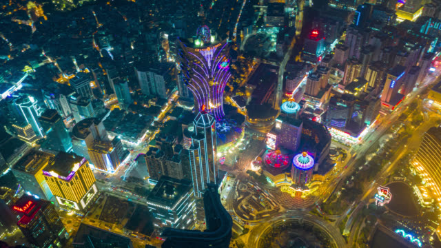 hyperlapse or dronelapse aerial view of macau cityscape and skyscraper in macau city near hong kong island, china at night - hong kong island stock videos & royalty-free footage