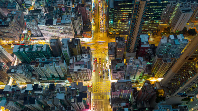 hyperlapse or dronelapse aerial view of traffic of car and crowded ai sham shui po district in hong kong city china - hyper lapse stock videos & royalty-free footage