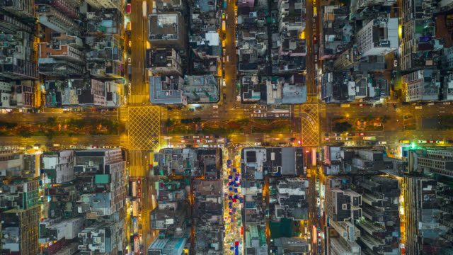 hyperlapse or dronelapse aerial view of traffic of car and crowded ai sham shui po district in hong kong city china - hong kong stock videos & royalty-free footage