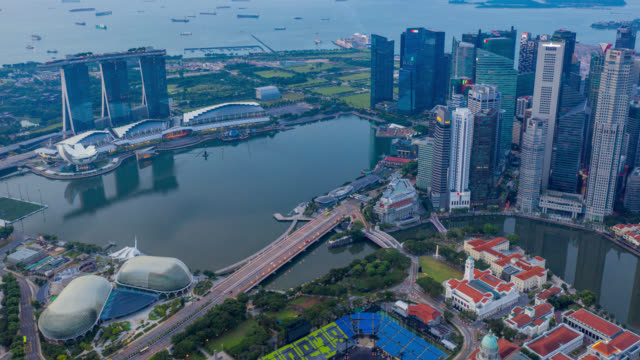 hyperlapse or dronelapse scene of singapore business district downtown - marina bay sands stock videos and b-roll footage