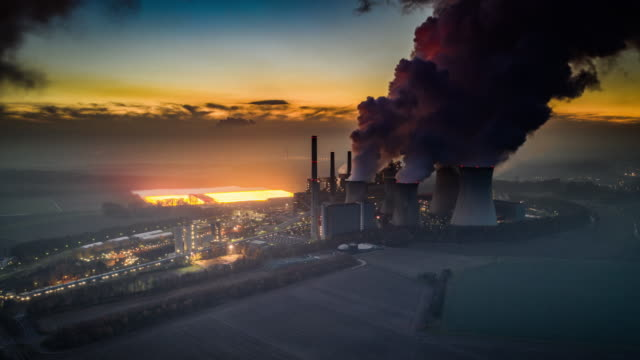 hyperlapse: power plant burning fossil fuels - environmental damage stock videos & royalty-free footage