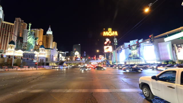 the las vegas strip shot from a moving vehicle at night on february 16th 2014 in las vegas nevada - the strip las vegas stock videos & royalty-free footage