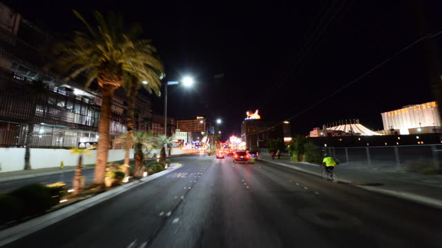the las vegas strip shot from a moving vehicle at night on february 16th 2014 in las vegas nevada - casino stock videos & royalty-free footage