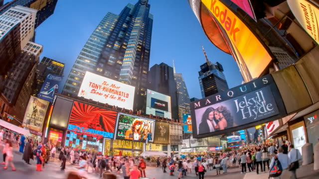 hyperlapse through times square at sunset - tabellone video stock e b–roll