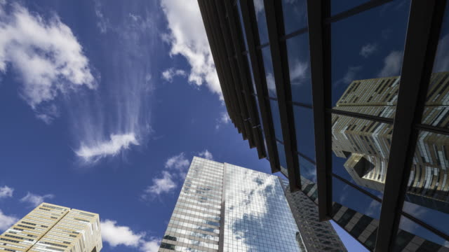 hyperlapse / time lapse along office buildings in business / financial district paris la defense - wide stock videos & royalty-free footage