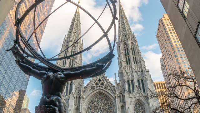 hyperlapse time lapse atlas statue, st. patrick's cathedral manhattan nyc. daytime afternoon. cloudy day. - st. patrick's cathedral manhattan stock videos and b-roll footage