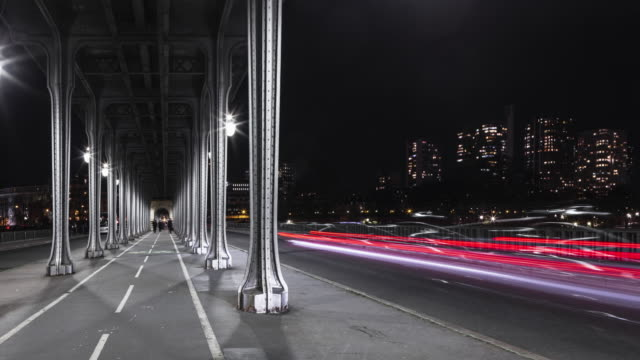 hyperlapse / time lapse on the bir hakeim bridge at night in paris - france stock videos & royalty-free footage