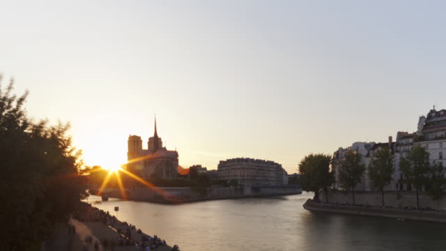 Hyperlapse Time lapse tracking shot day to night on bridge on Seine river with Notre Dame Paris